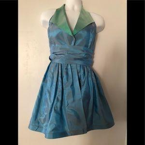 Blue iridescent halter dress with wide sash belt.